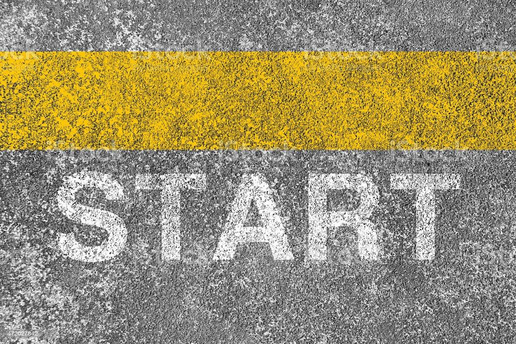 Yellow starting line made of chalk stock photo
