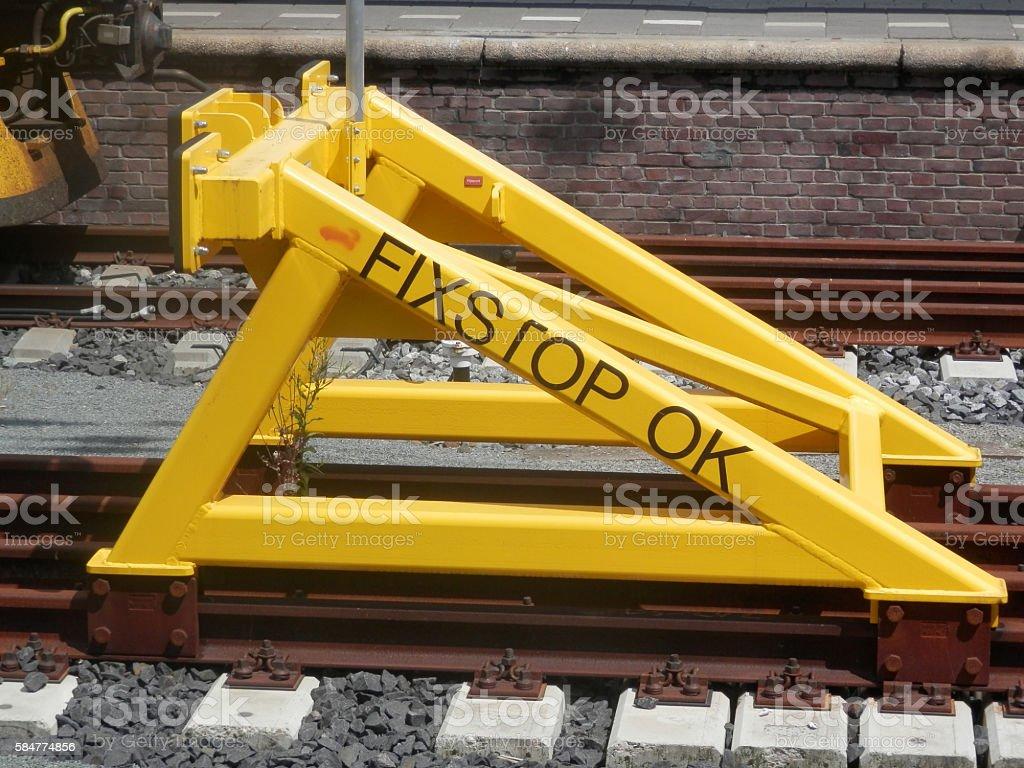 Yellow steel railway buffer stock photo