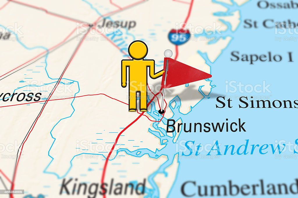 Yellow Stickman Holding a Map Pin on Brunswick, GA stock photo