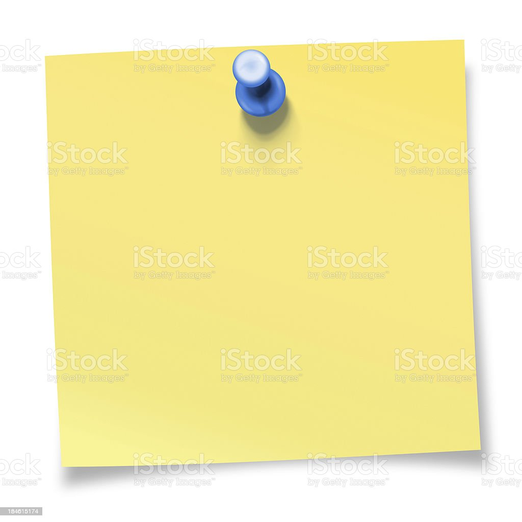 Yellow sticky note pinned with blue thumbtack stock photo
