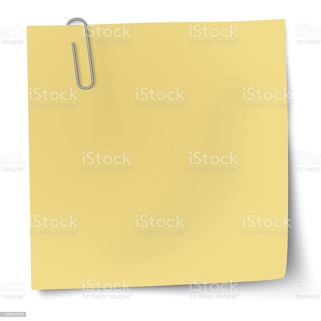 Yellow sticky note with metallic paper clip stock photo