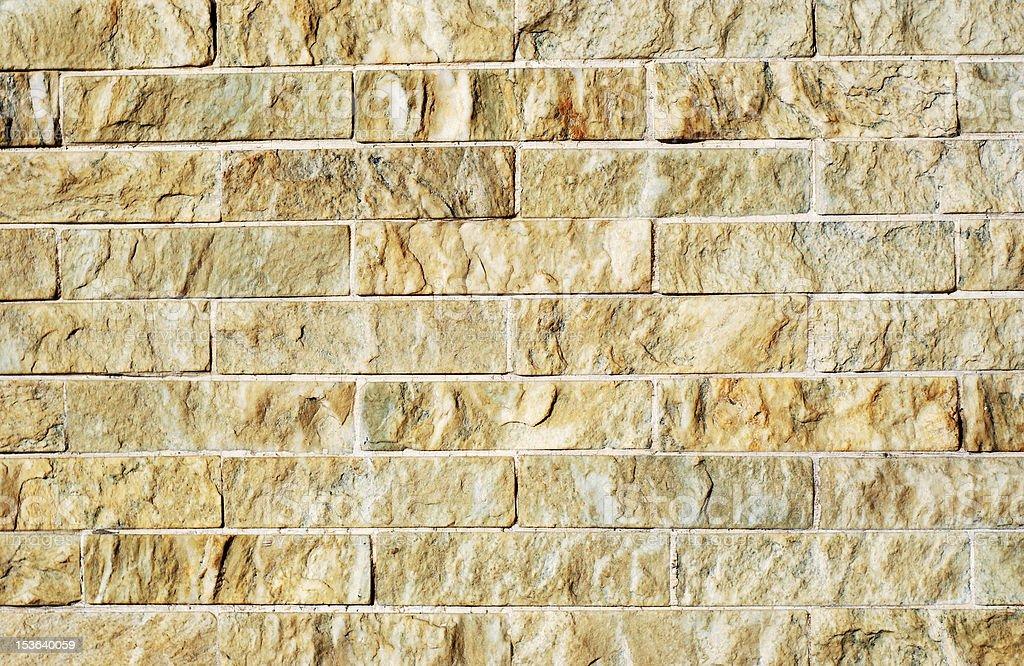 Yellow stone brick wall texture royalty-free stock photo