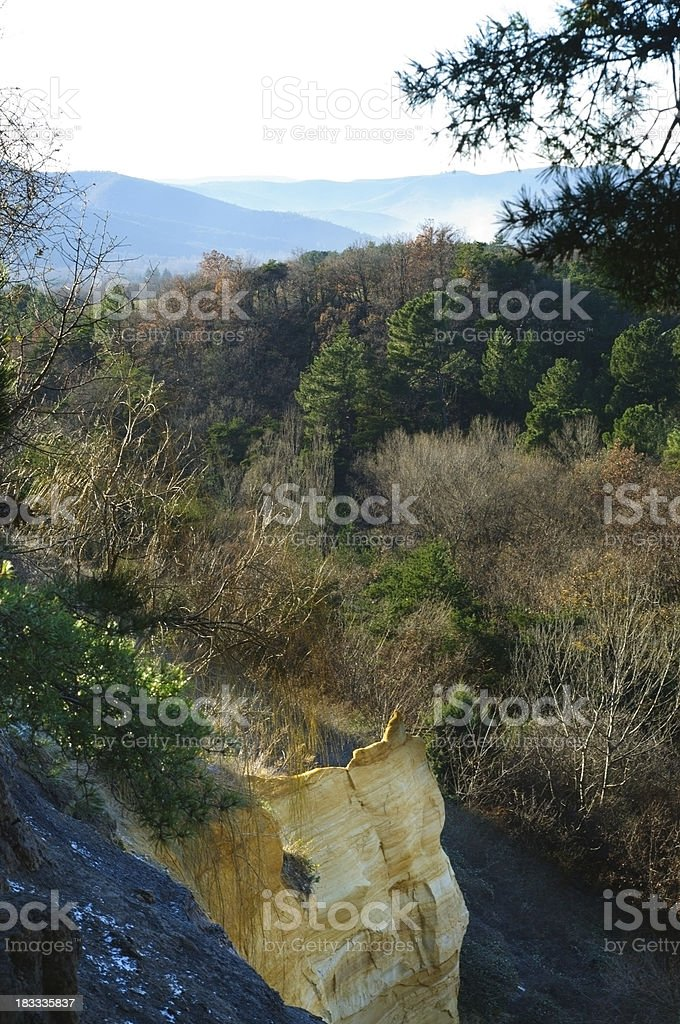 yellow stone cliff in Provence, France stock photo