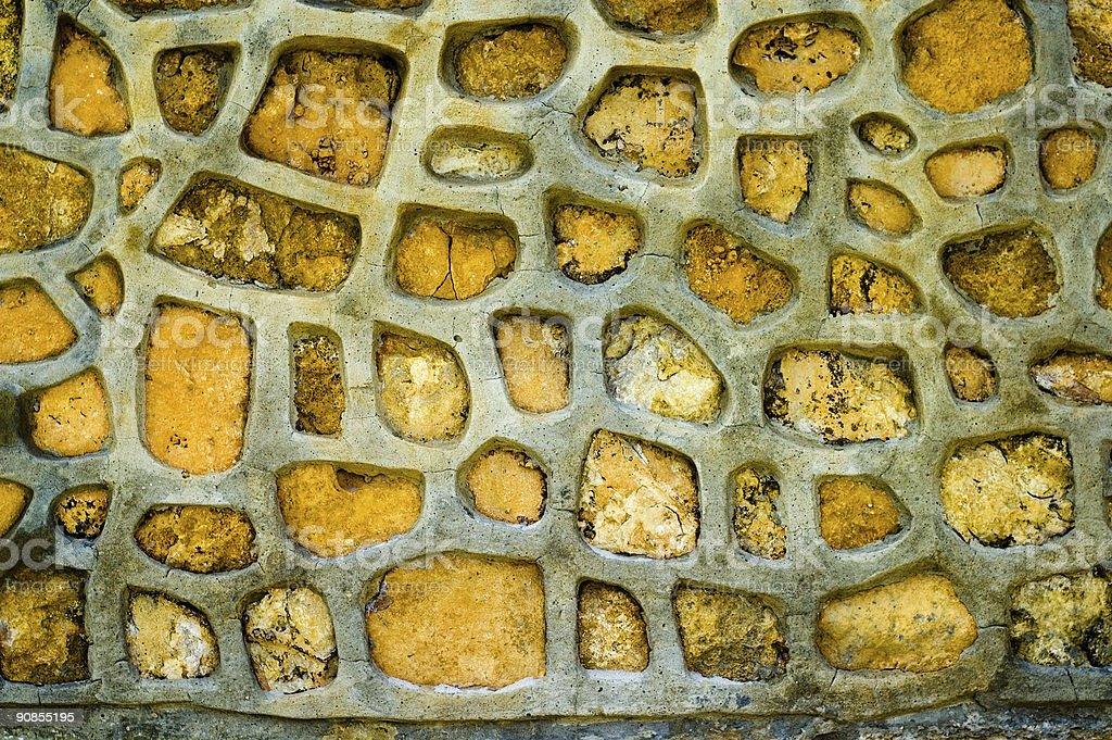 Yellow stone wall texture royalty-free stock photo