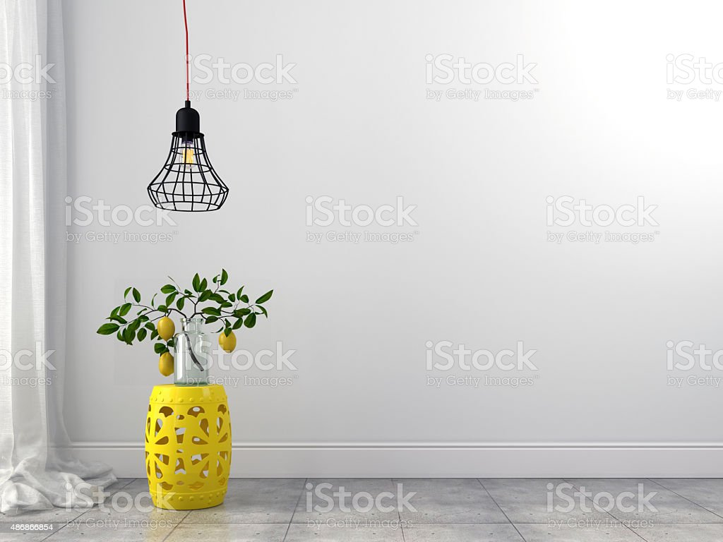 Yellow stool and wire chandelier stock photo