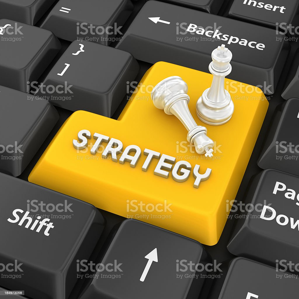 Yellow STRATEGY keyboard key with two chess pieces royalty-free stock photo