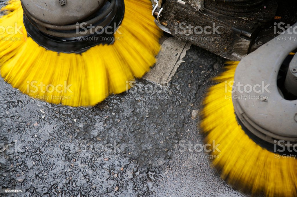 Yellow Street Sweeper in Action stock photo