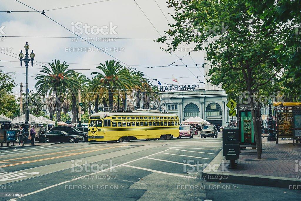 Yellow Streetcar At Ferry Terminal In San Francisco stock photo