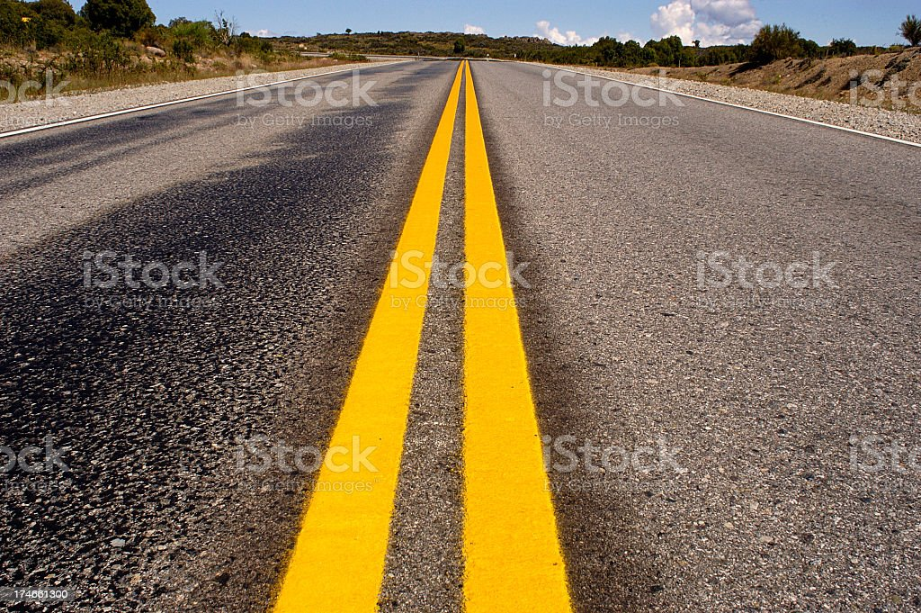 Yellow strips on road royalty-free stock photo