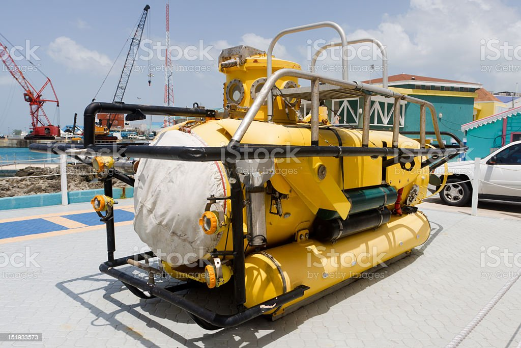 Yellow submarine sitting on the dock royalty-free stock photo