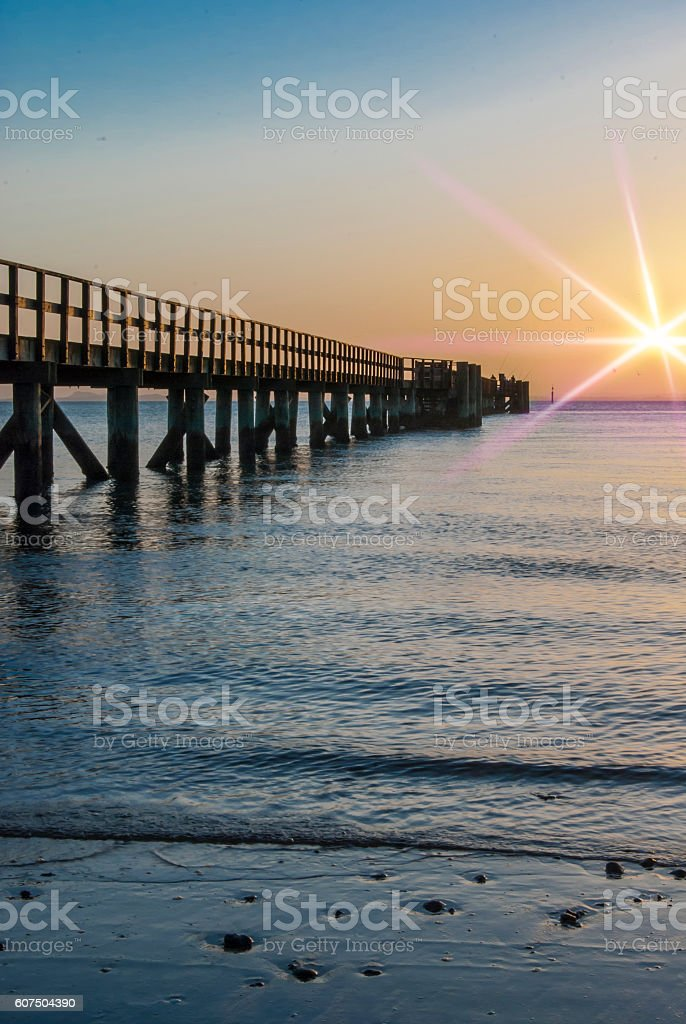 Yellow sunrise with flare stock photo