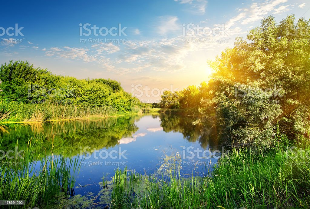 Yellow sunset over river stock photo