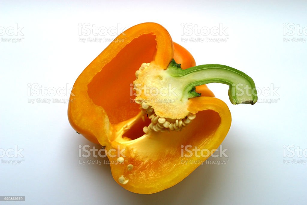 yellow sweet pepper cut half-and-half stock photo