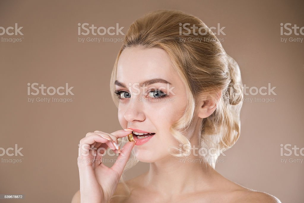 Yellow tablet in the hands of a woman stock photo