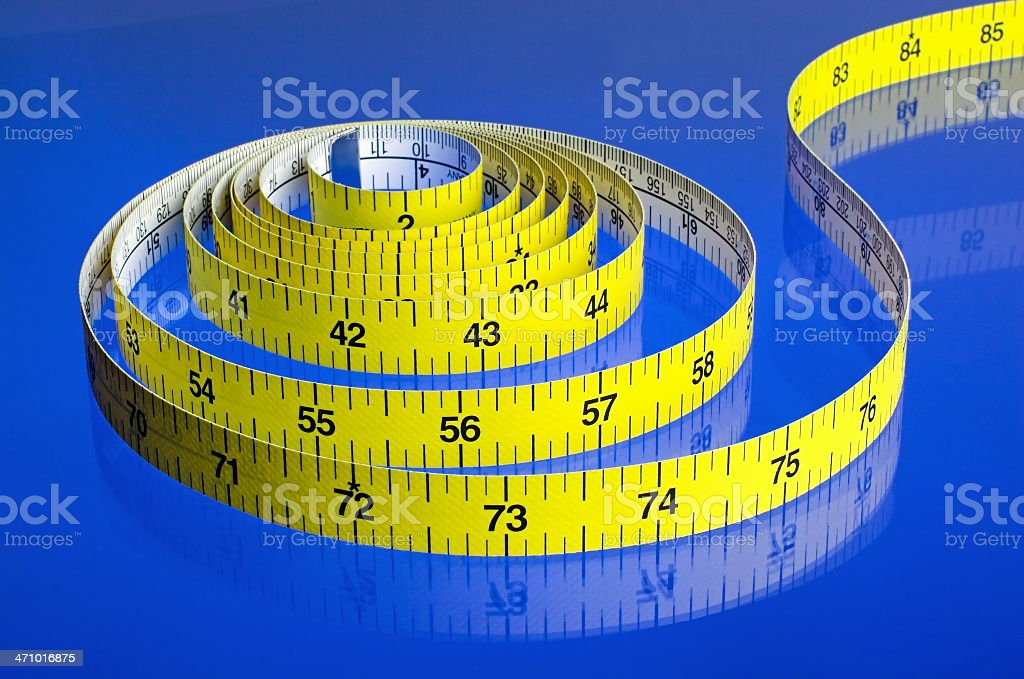 Yellow Tape Measure on Blue Background royalty-free stock photo