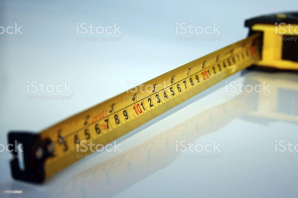 Yellow tape measure stock photo