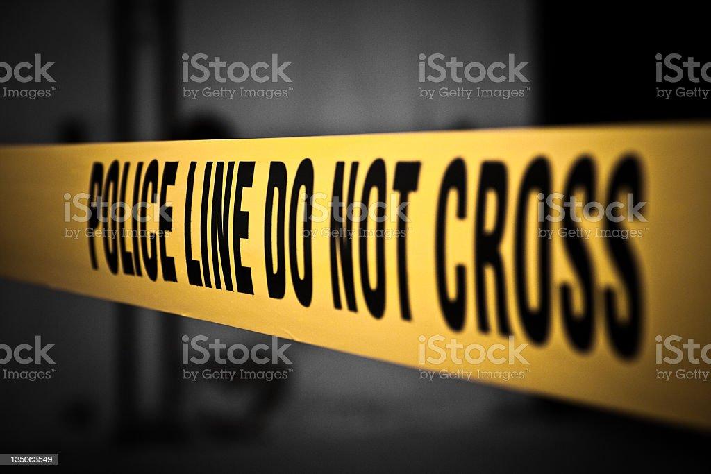 Yellow Tape Police Line Do Not Cross Crime Scene Investigation stock photo