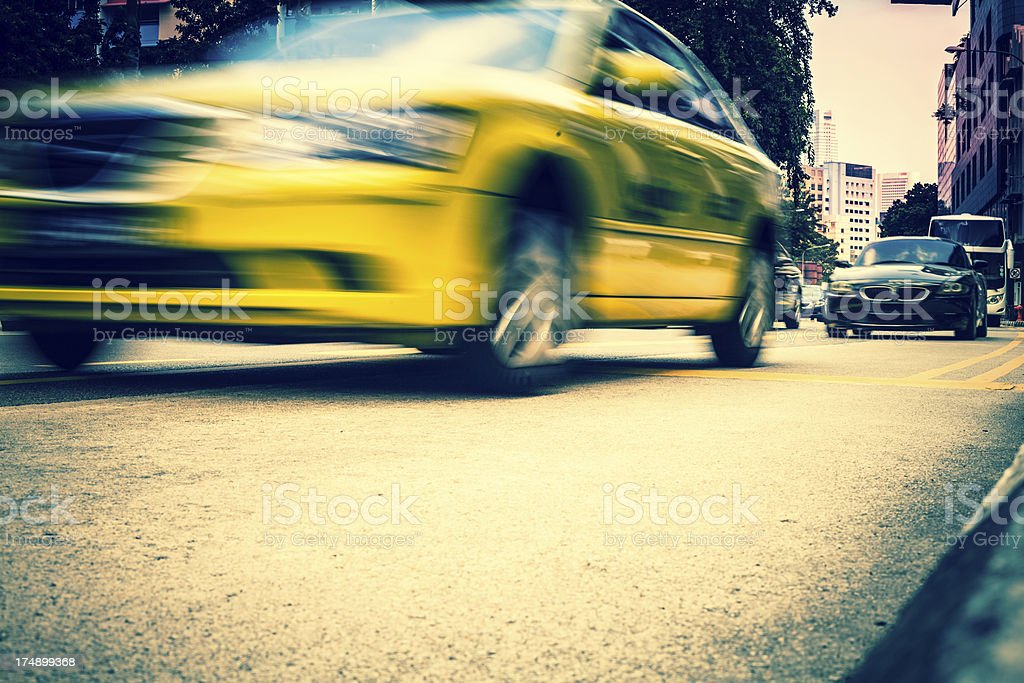 Yellow Taxi and Car Traffic in Singapore royalty-free stock photo