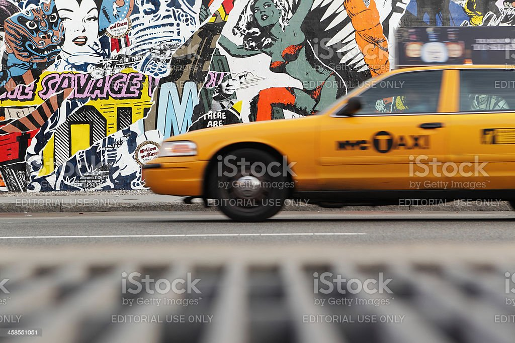 NYC yellow taxi and mural wall on Houston Street stock photo