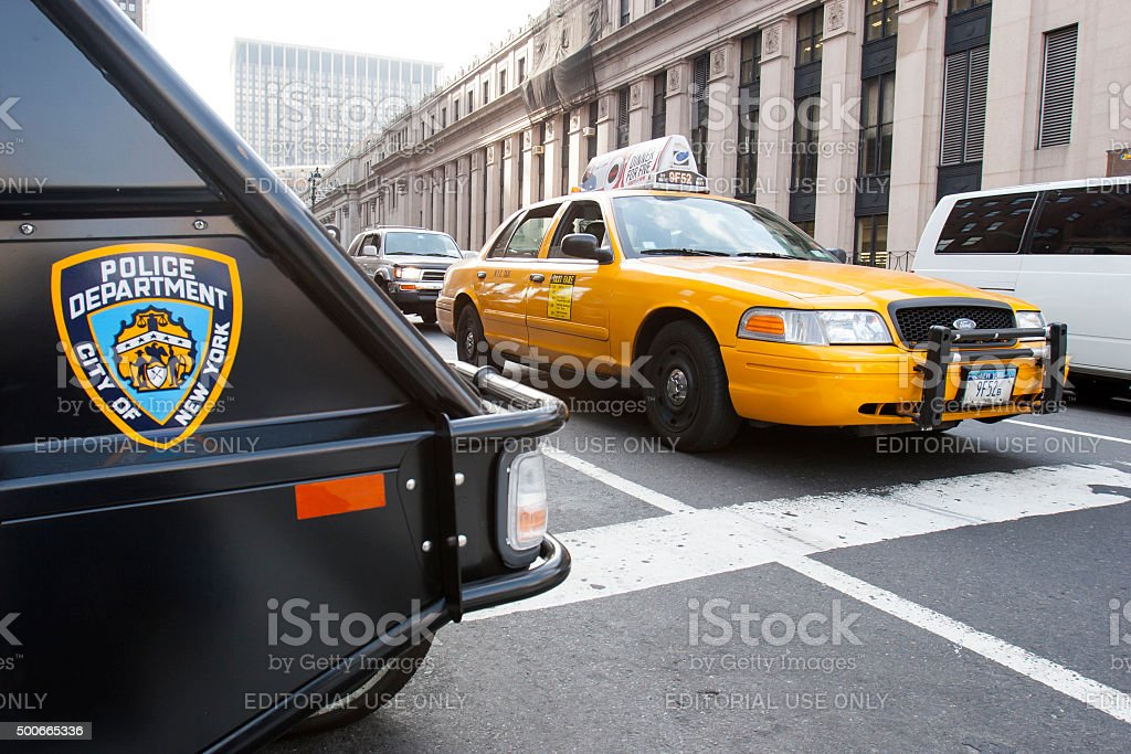 Yellow taxi and Nypd vehicle in Manhattan stock photo