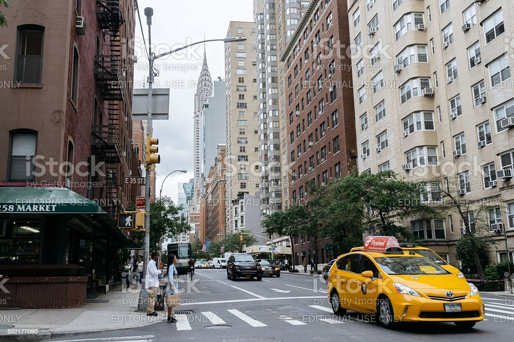 Yellow taxi and people on the street of New York. stock photo