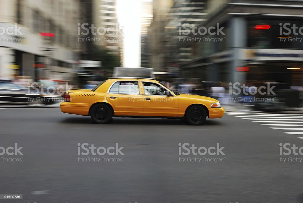 Yellow Taxi cab moving with speed on the street royalty-free stock photo