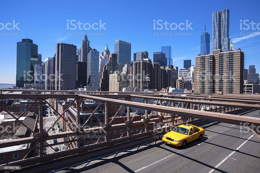 Yellow Taxi Cab on Brooklyn Bridge and Manhattan Skyline royalty-free stock photo