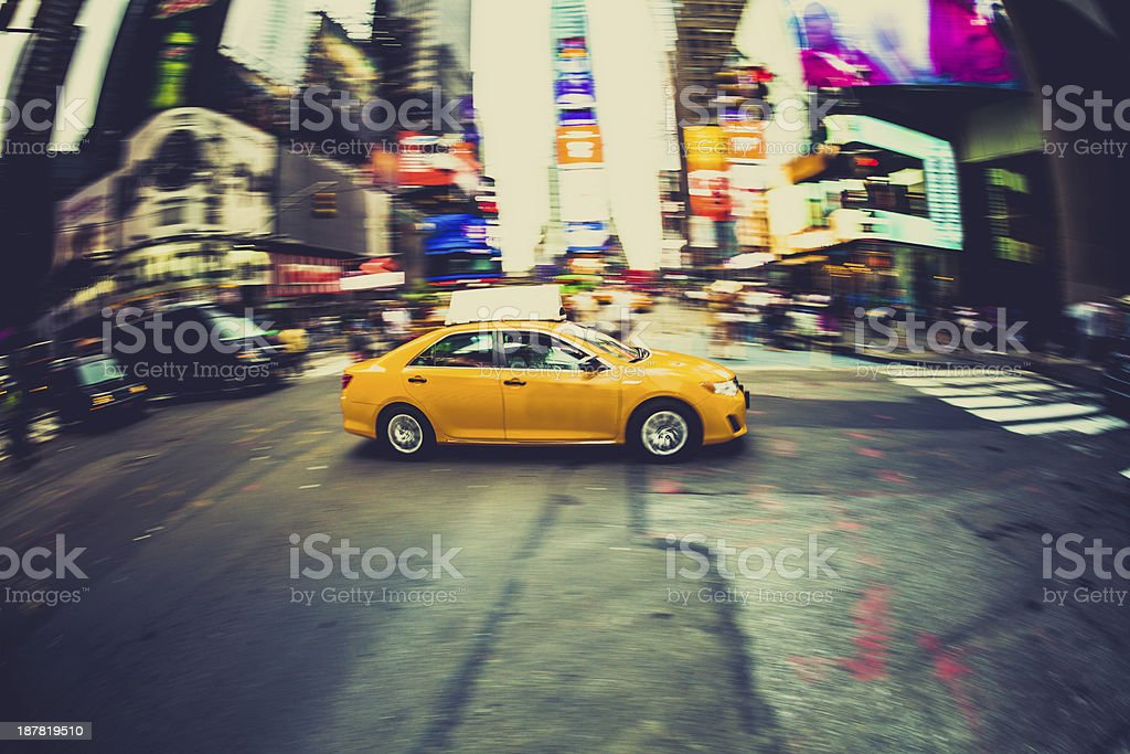 Yellow Taxi Driving in Times Square, New York City royalty-free stock photo