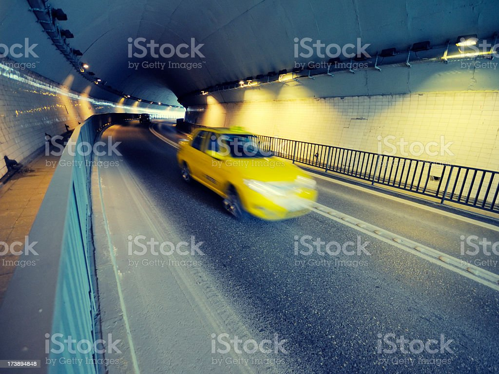Yellow taxi in a tunnel in Istanbul stock photo