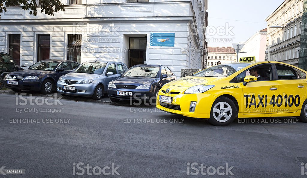 Yellow taxi in the city center of Vienna, Austria royalty-free stock photo