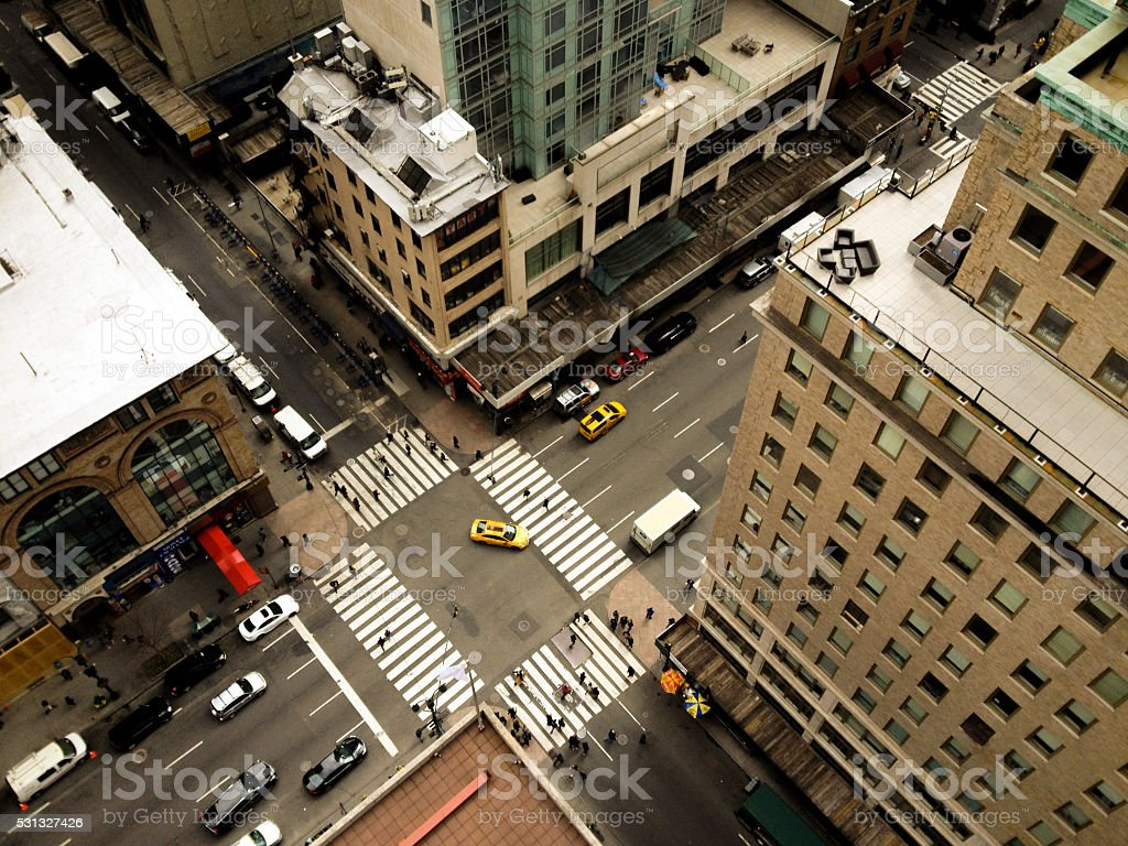 Yellow taxi making left hand turn on to 5th Avenue stock photo