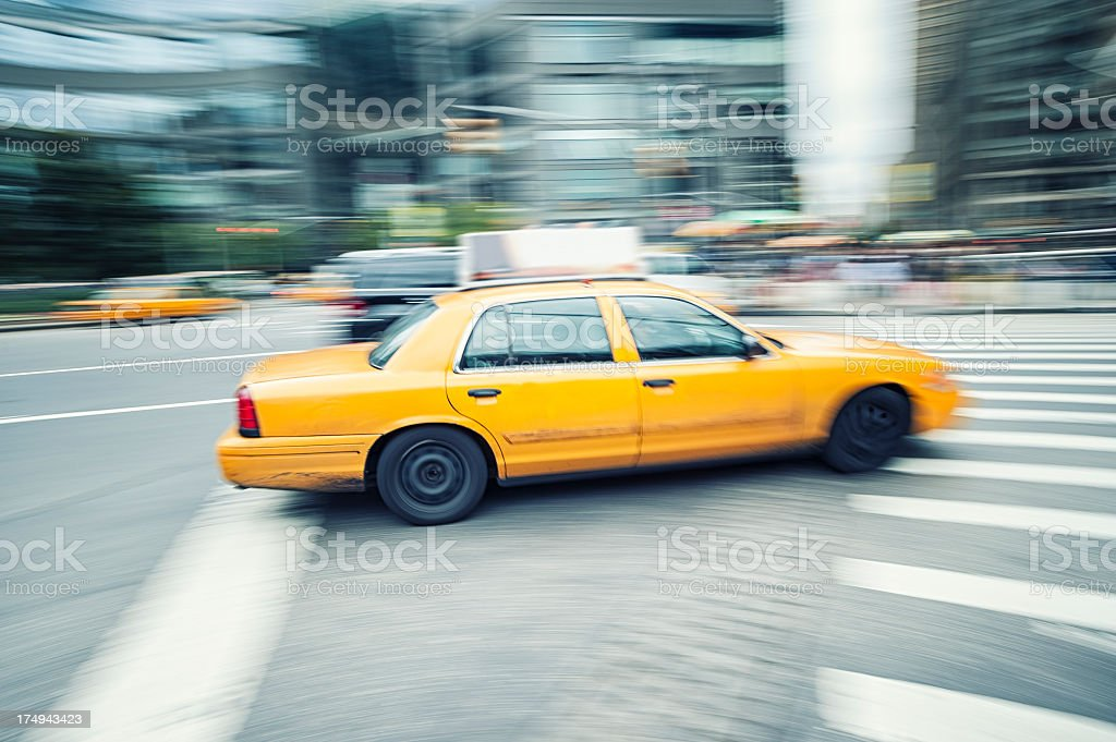 Yellow taxi running in New York City royalty-free stock photo