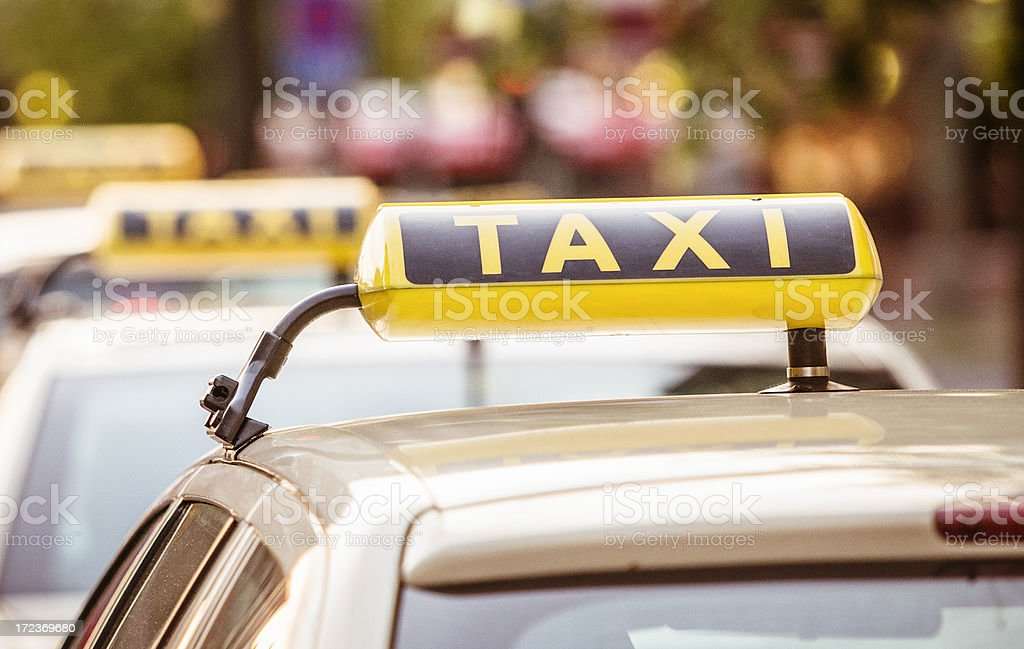 Yellow taxi sign and cab stock photo