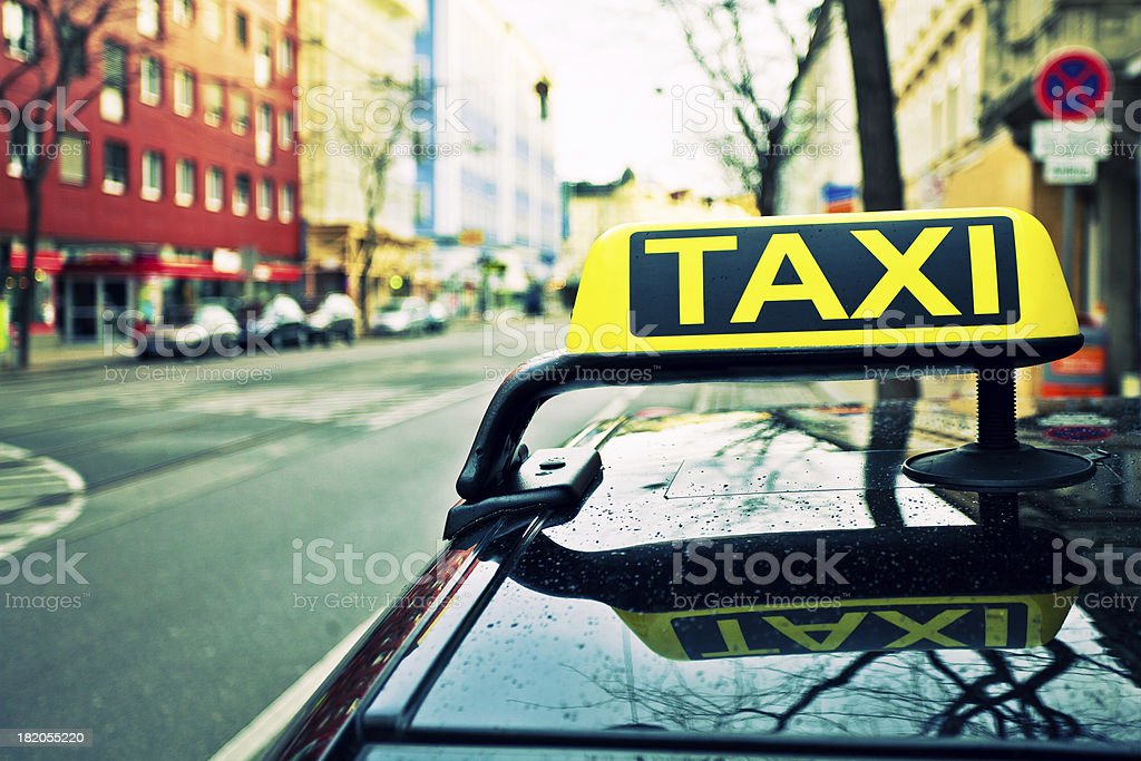 Yellow Taxi Sign on a Car royalty-free stock photo
