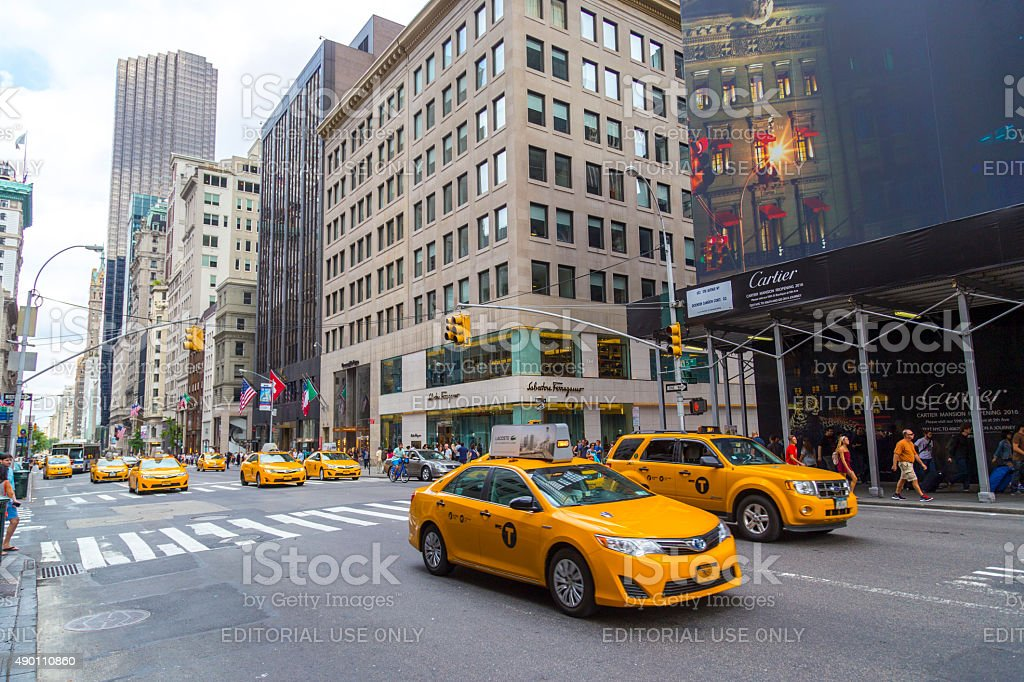 Yellow taxis ride on 5th Avenue in New York City stock photo