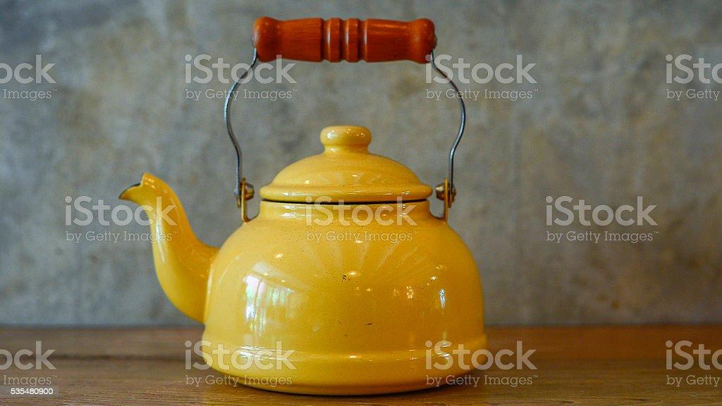 Yellow teapot stock photo