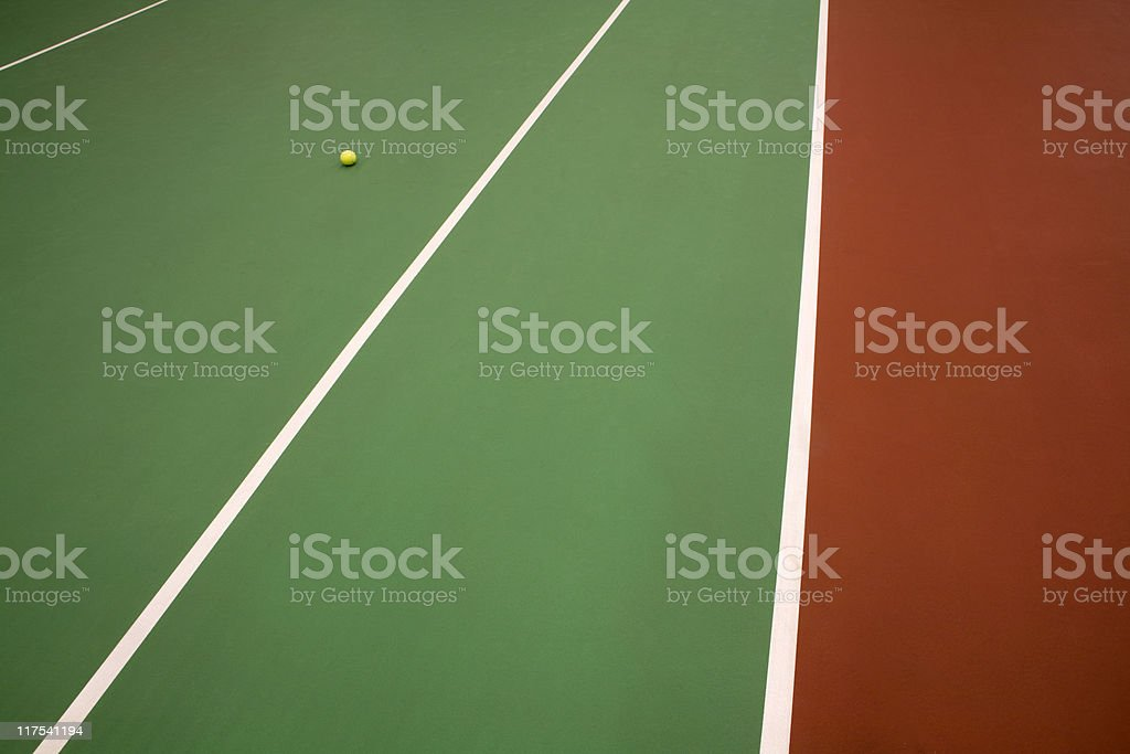 yellow tennis ball on an indoor court royalty-free stock photo