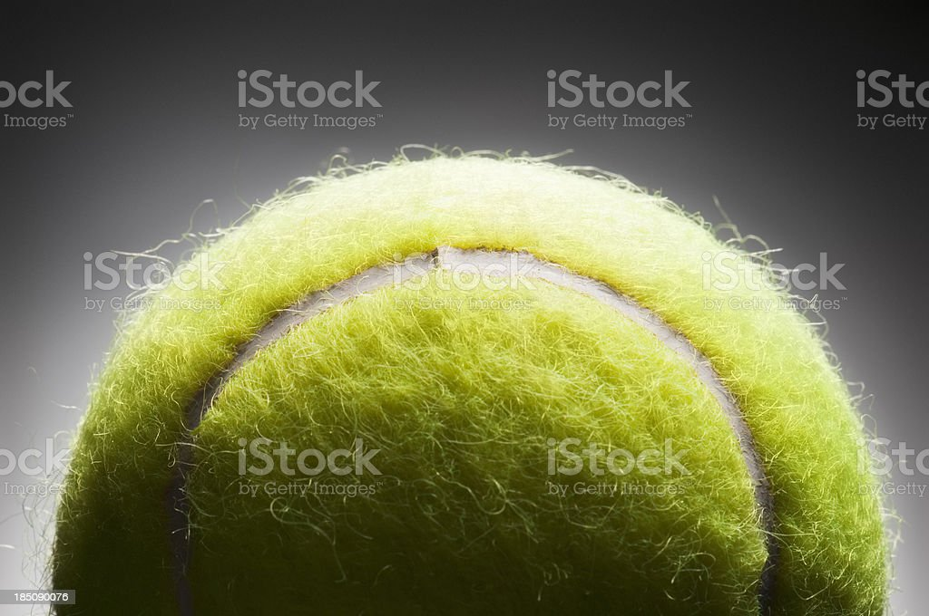 Yellow tennis ball on black background with copy space royalty-free stock photo