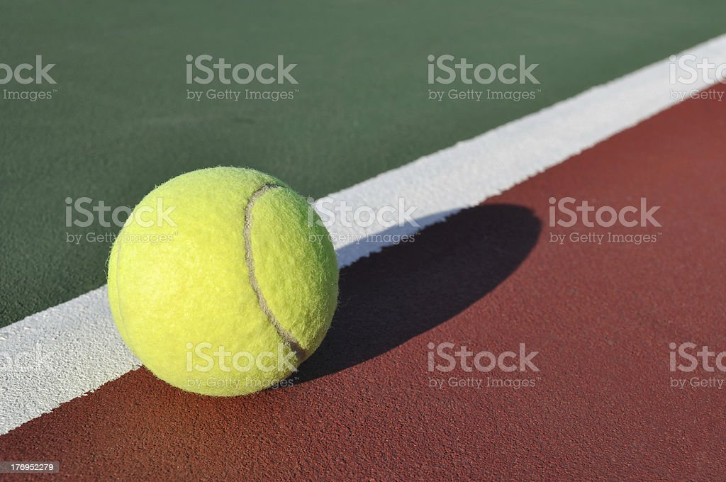 Yellow Tennis Ball on Court royalty-free stock photo