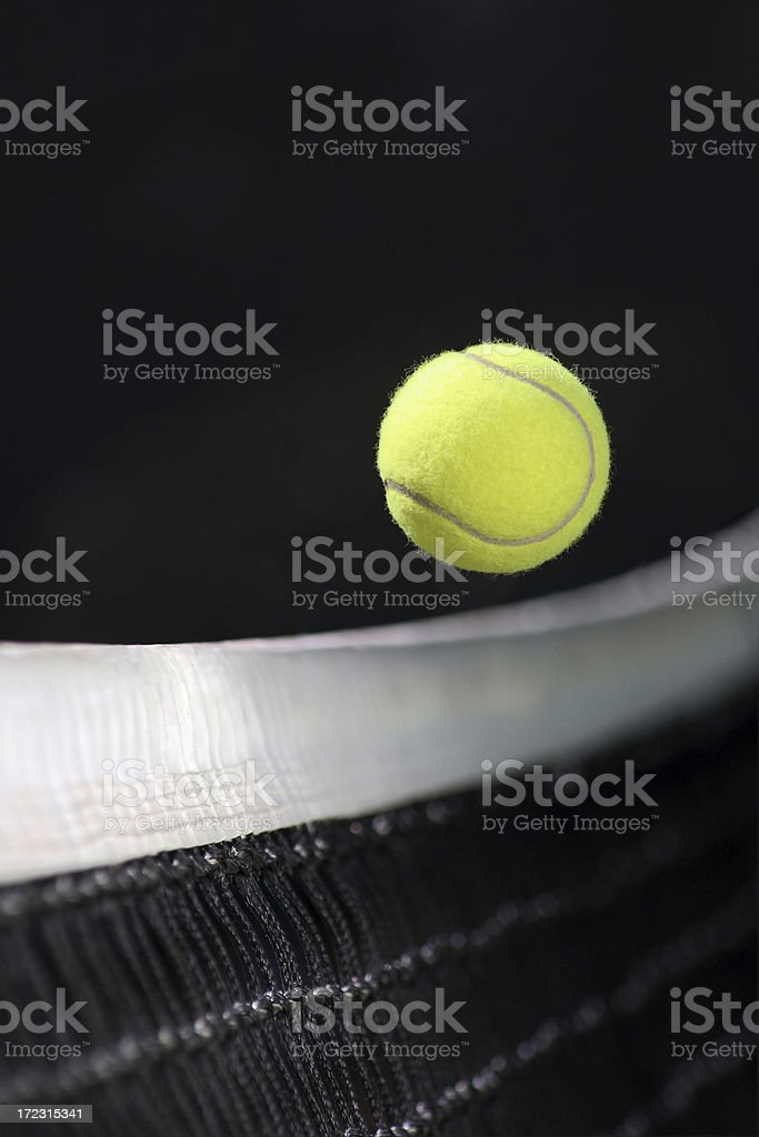 Yellow tennis ball over the net royalty-free stock photo