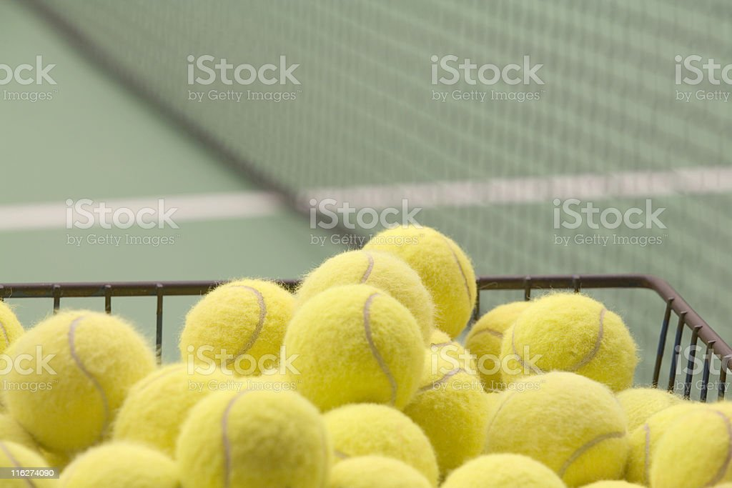 yellow tennis balls in an iron basket royalty-free stock photo