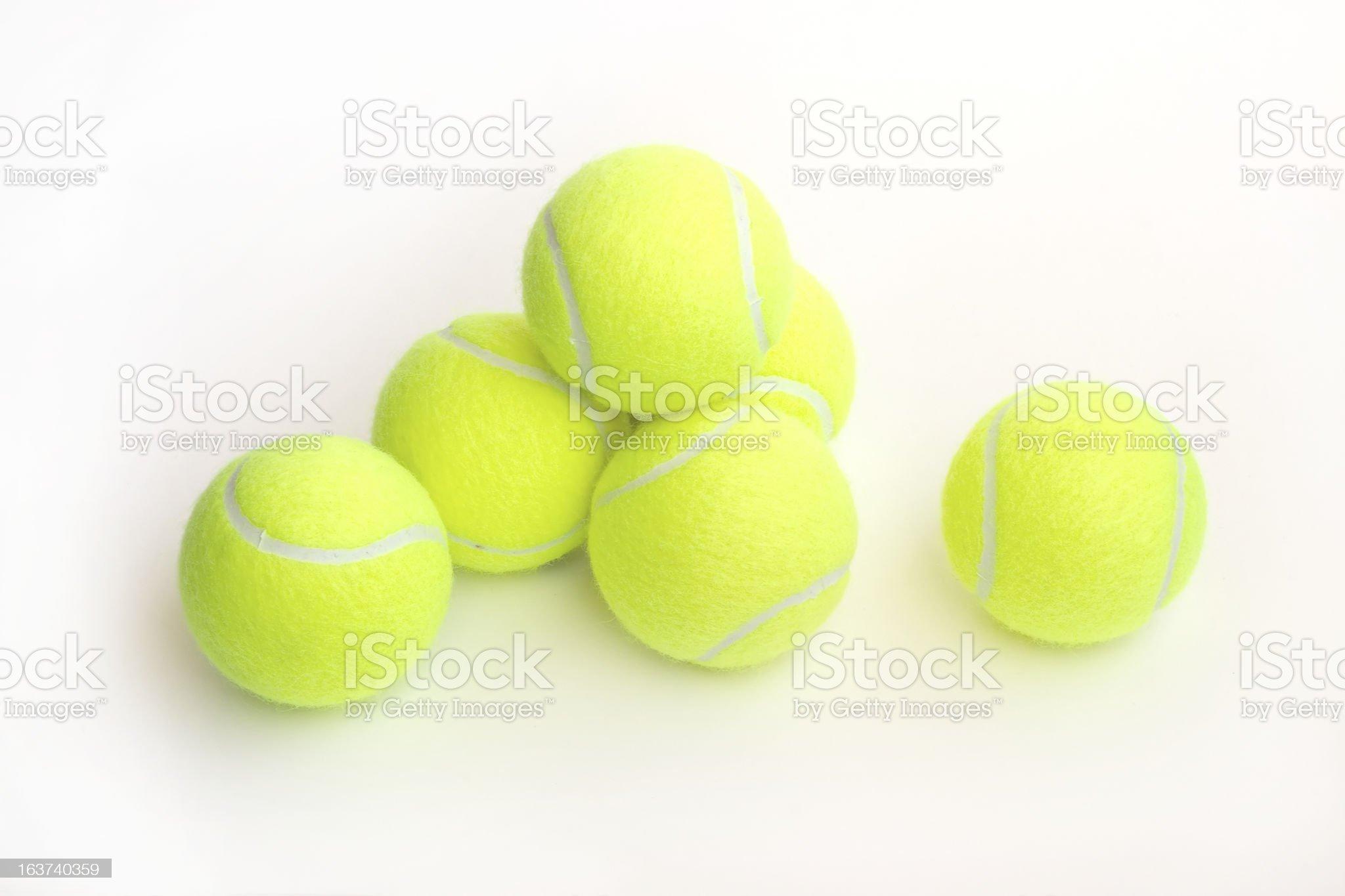 Yellow tennis balls on white closeup royalty-free stock photo