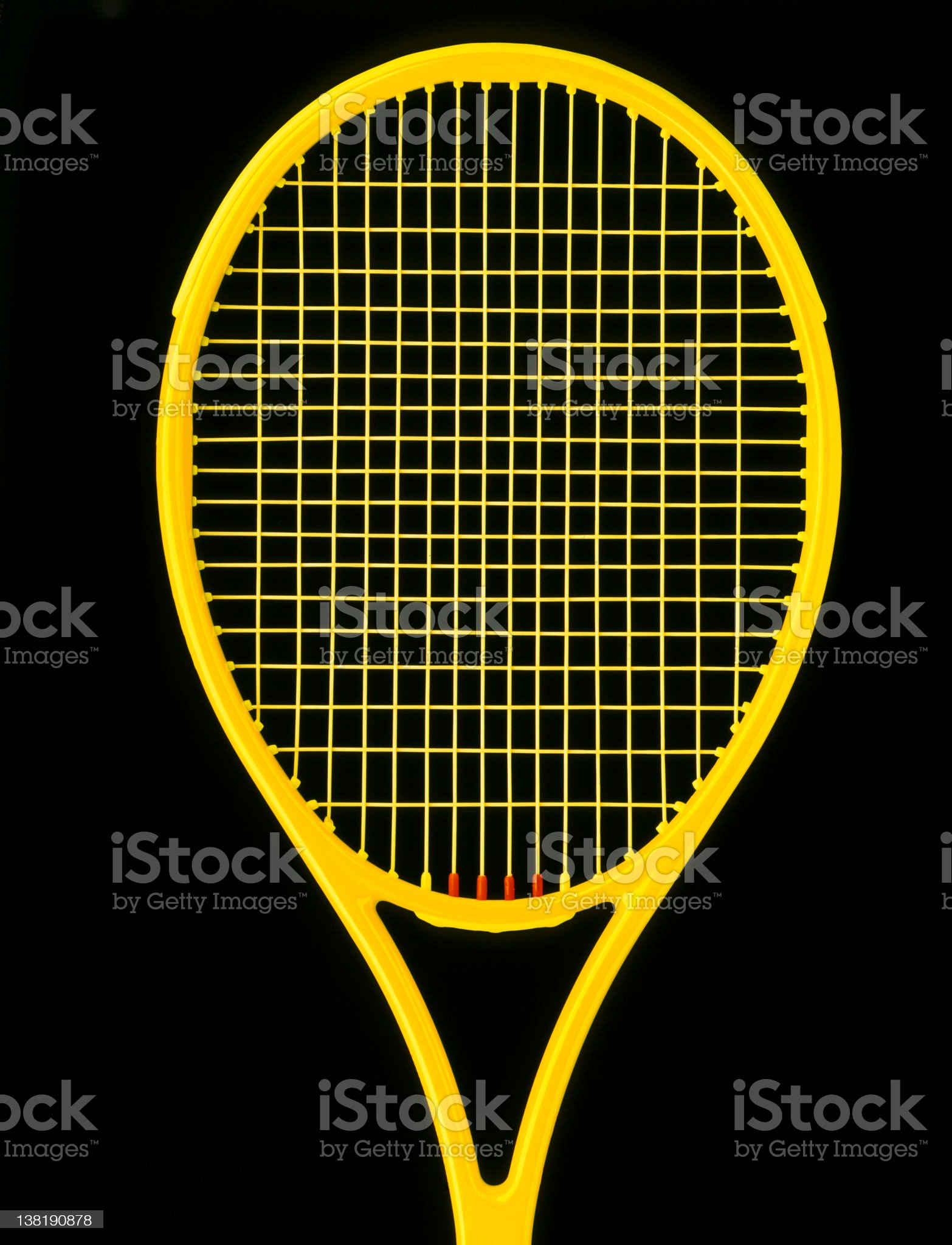 Yellow tennis racket on black background royalty-free stock photo