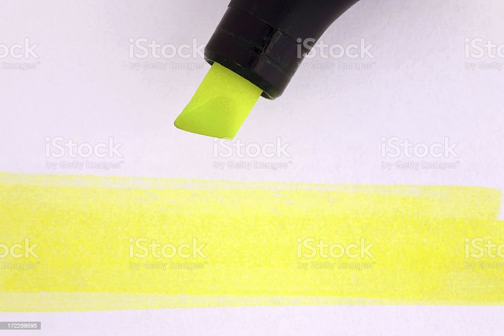 Yellow textmarker on a white paper with highlighted area royalty-free stock photo