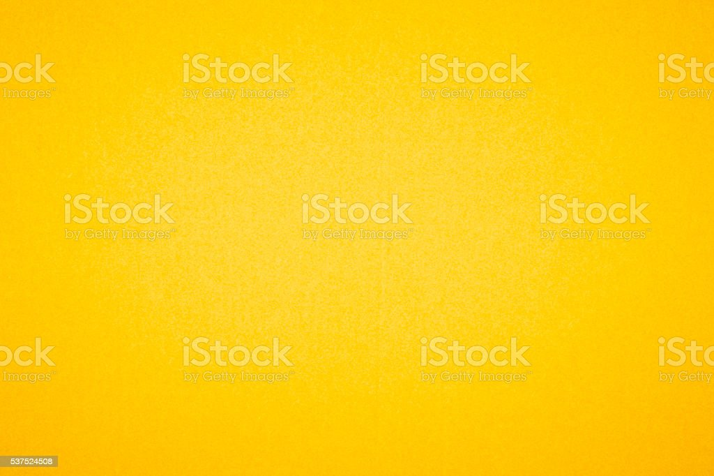Yellow textured paper background stock photo