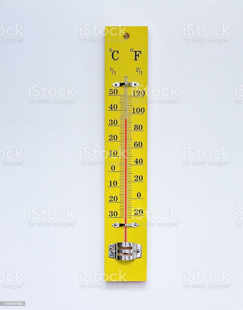 Yellow thermometer on white background. stock photo
