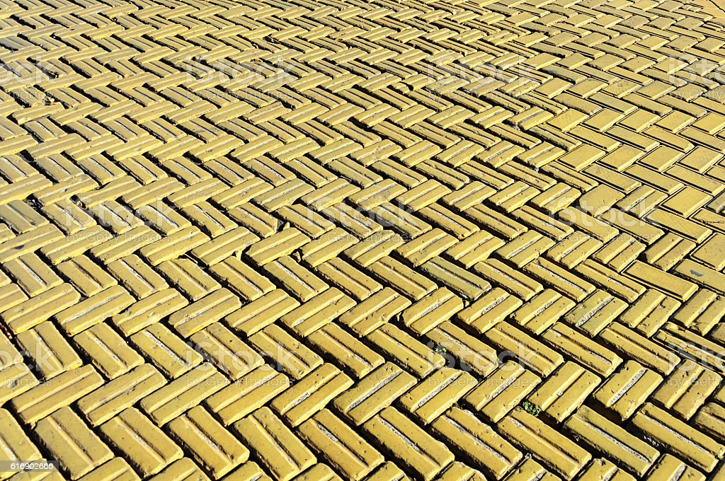 Yellow tiled road background stock photo