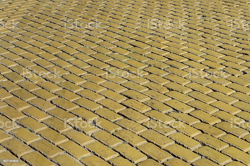 Yellow tiled road surface stock photo