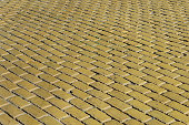 Yellow tiled road surface