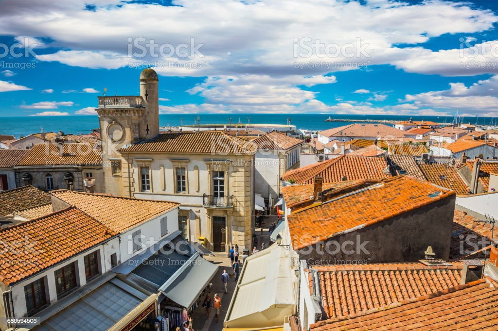 Yellow tiled roofs and Mediterranean Sea stock photo
